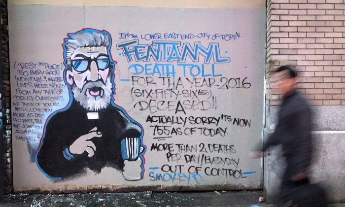 A mural in the Downtown Eastside of Vancouver by street artist Smokey D. painted as a response to the fentanyl and opioid overdose crisis, Dec. 22, 2016. (The Canadian Press/Darryl Dyck)