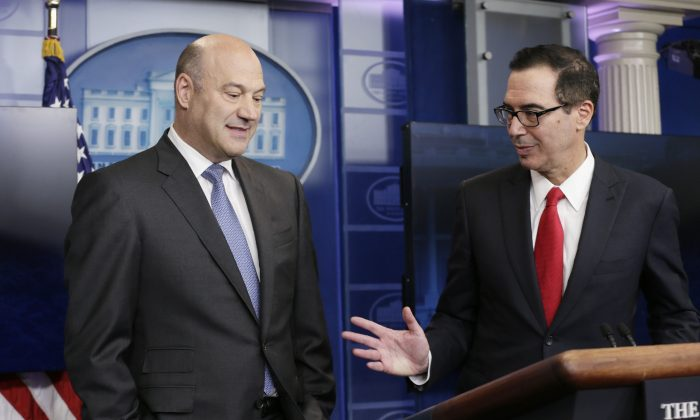 National Economic Director Gary Cohn (L) and Treasury Secretary Steven Mnuchin discuss the Trump administration's tax reform proposal in the White House briefing room in Washington on April 26, 2017. (REUTERS/Kevin Lamarque)