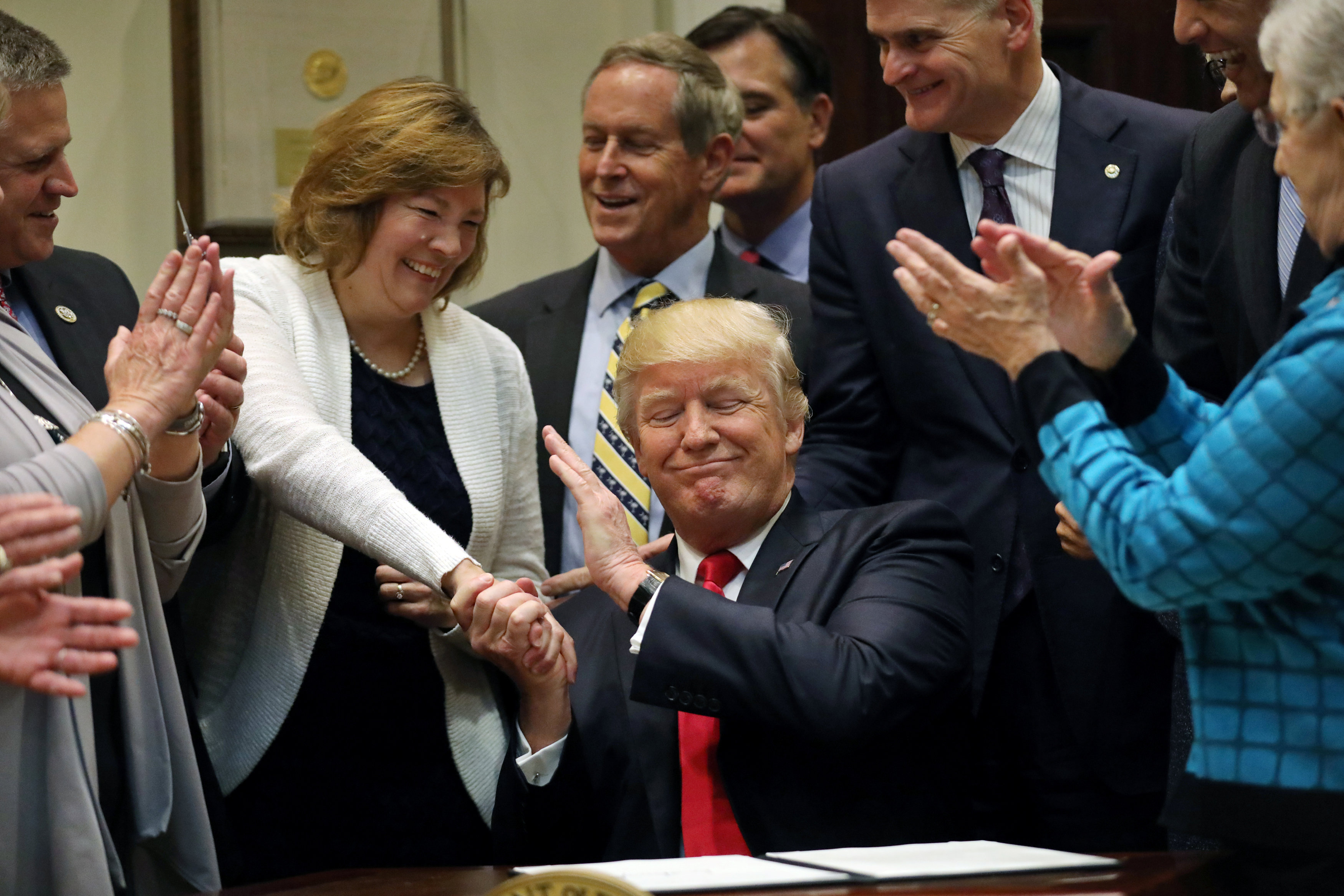 President Donald Trump reacts after signing an executive order on education during an event with Governors at the White House in Washington on April 26, 2017. (REUTERS/Carlos Barria)