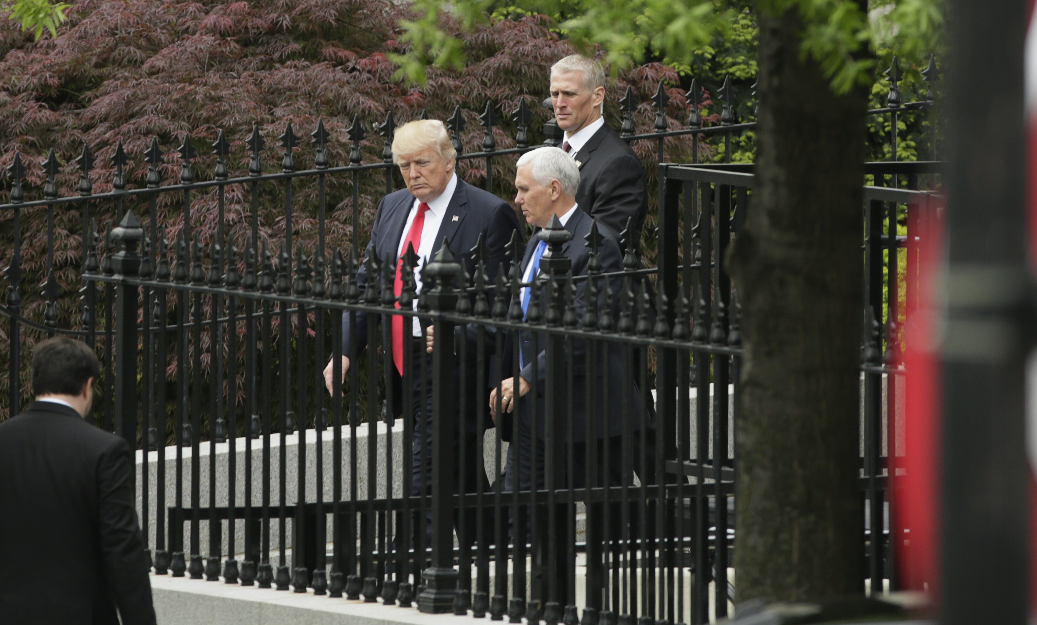 President Donald Trump and Vice President Mike Pence leave a briefing for members of the U.S. Senate on North Korea at the White House in Washington on April 26, 2017. (REUTERS/Kevin Lamarque)