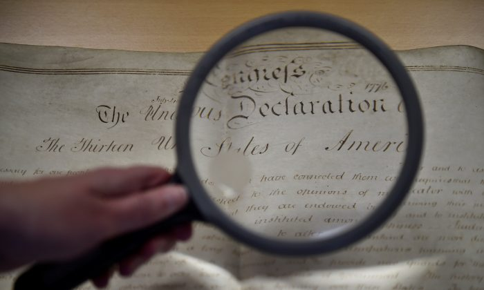 A rare handwritten copy of the U.S. Declaration of Independence is seen at the West Sussex Record Office in Chichester in south England, Britain on April 27, 2017. (REUTERS/Hannah McKay)