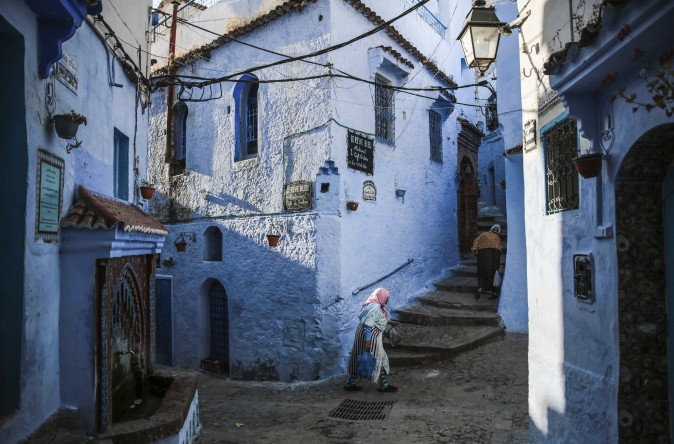 Women walk in an alleyway in the Medina of Chefchaouen, a picturesque town well-known for its blue painted houses and alleyways in northern Morocco on April 27, 2017. (AP Photo/Mosa'ab Elshamy)