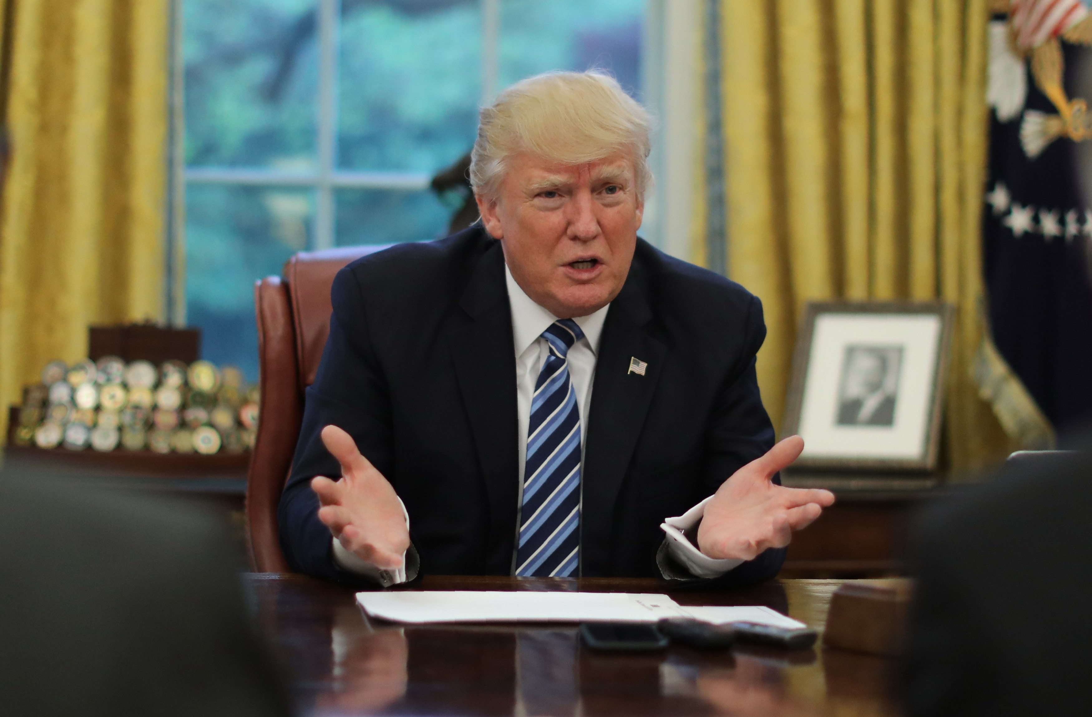 President Donald Trump speaks during an interview with Reuters in the Oval Office of the White House in Washington, U.S., April 27, 2017. (REUTERS/Carlos Barria)