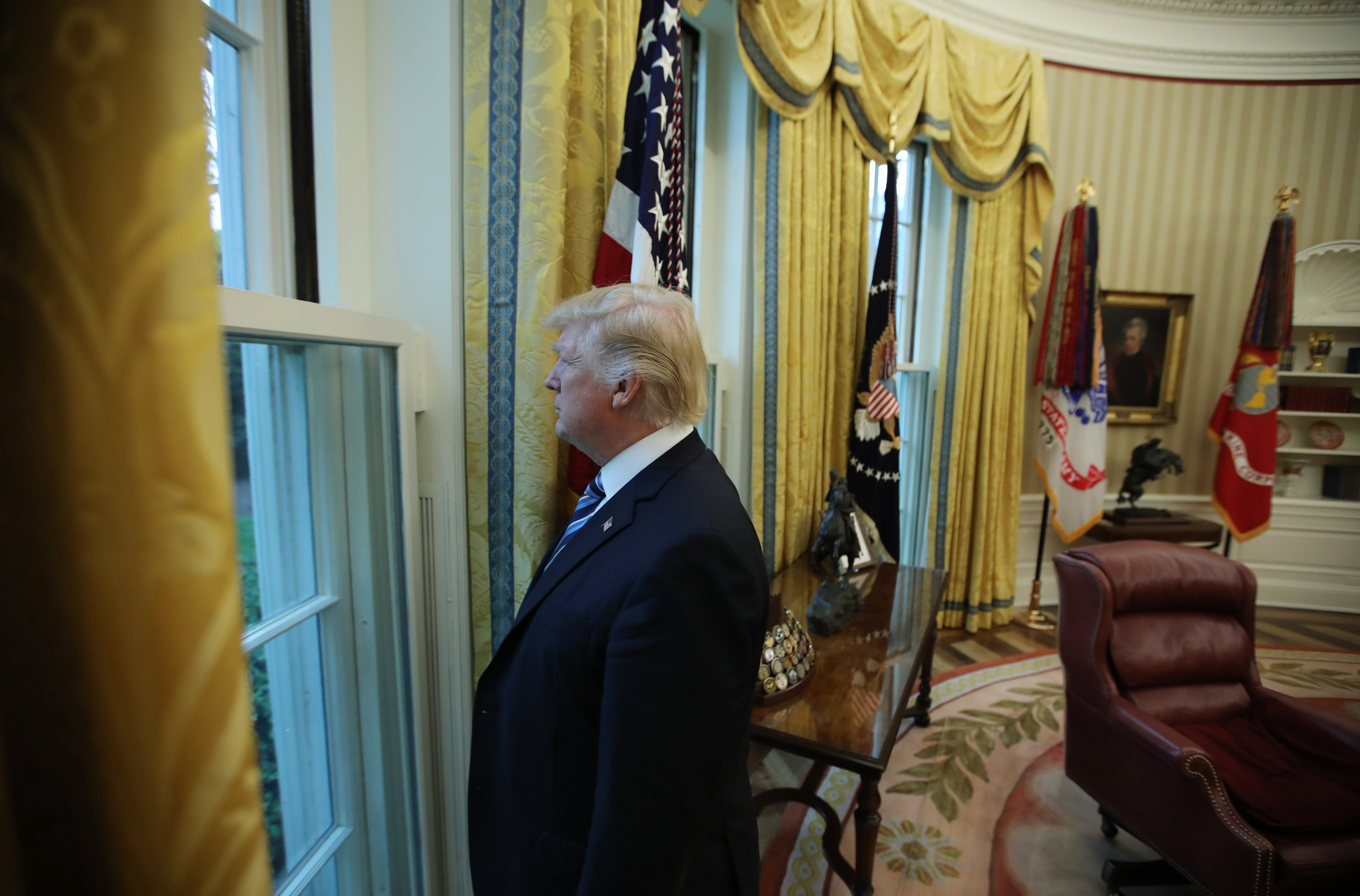 President Donald Trump looks out a window of the Oval Office following an interview with Reuters at the White House in Washington on April 27, 2017. (REUTERS/Carlos Barria)