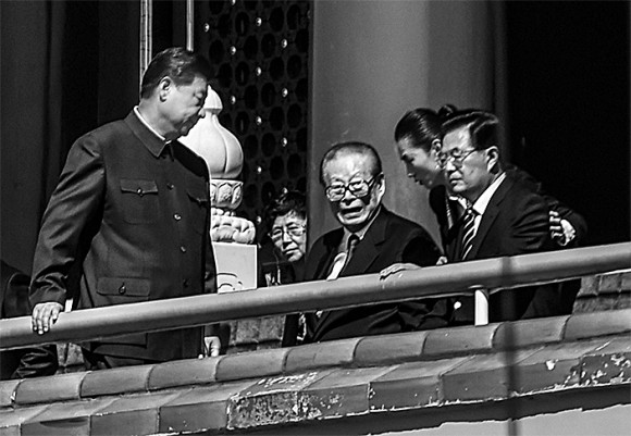 (L–R) Chinese leader Xi Jinping, and former Chinese Communist Party leaders Jiang Zemin and Hu Jintao, attend a military parade at Tiananmen Square in Beijing on Sept. 3, 2015. (Greg Baker/AFP/Getty Images)
