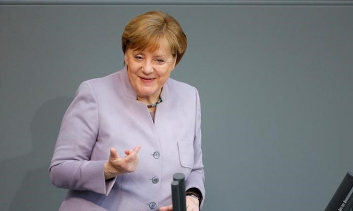 German Chancellor Angela Merkel addresses the lower house of parliament Bundestag in Berlin, Germany on April 27, 2017.      (REUTERS/Hannibal Hanschke)