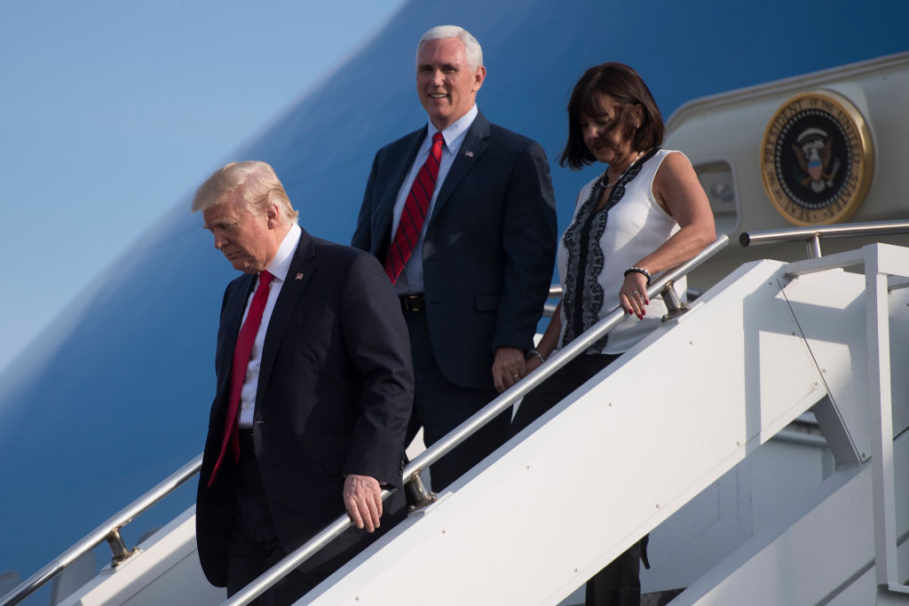 President Donald Trump (L) steps off Air Force One with Vice President Mike Pence and his wife Karen Pence n Middletown, Pa., on April 29, 2017. (JIM WATSON/AFP/Getty Images)