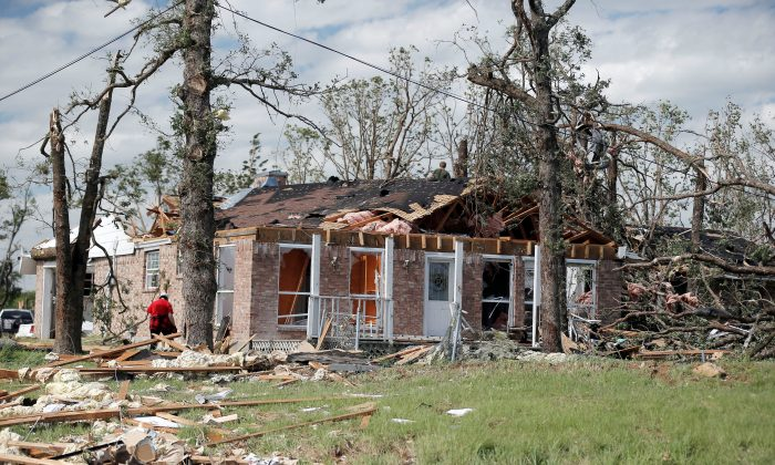 Homeowners clean up debris after a tornado hit the town of Emory, Texas. (REUTERS/Brandon Wade)