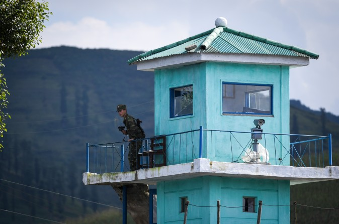 A North Korean soldier mans a guard post near the North Korean town of Sinuiju, opposite of the Chinese border city of Dandong on Sept. 11, 2016. (GREG BAKER/AFP/Getty Images)