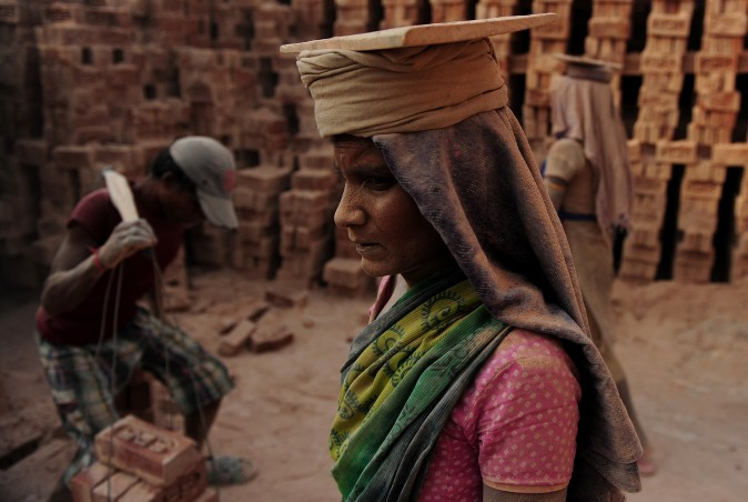 An laborer works at a brick factory near Allahabad, India, on April 30, 2017, on the eve of International Labour Day. (SANJAY KANOJIA/AFP/Getty Images)