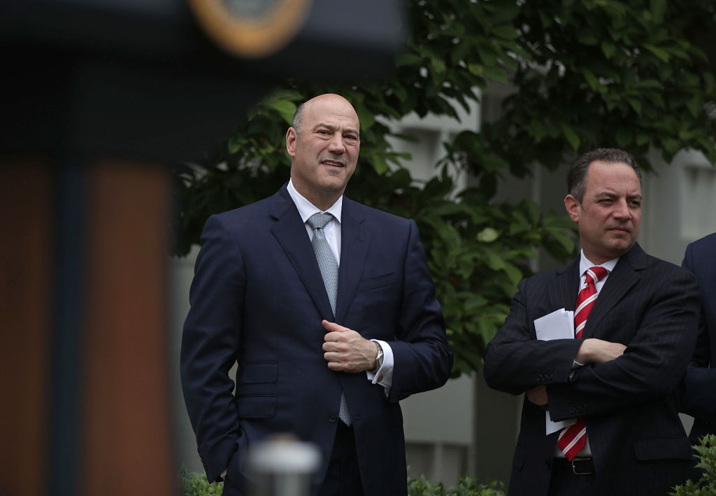 Director of the National Economic Council Gary Cohn (L) and White House Chief of Staff Reince Priebus (R) listen druing an event at the Kennedy Garden of the White House in Washington on May 1, 2017. (Alex Wong/Getty Images)