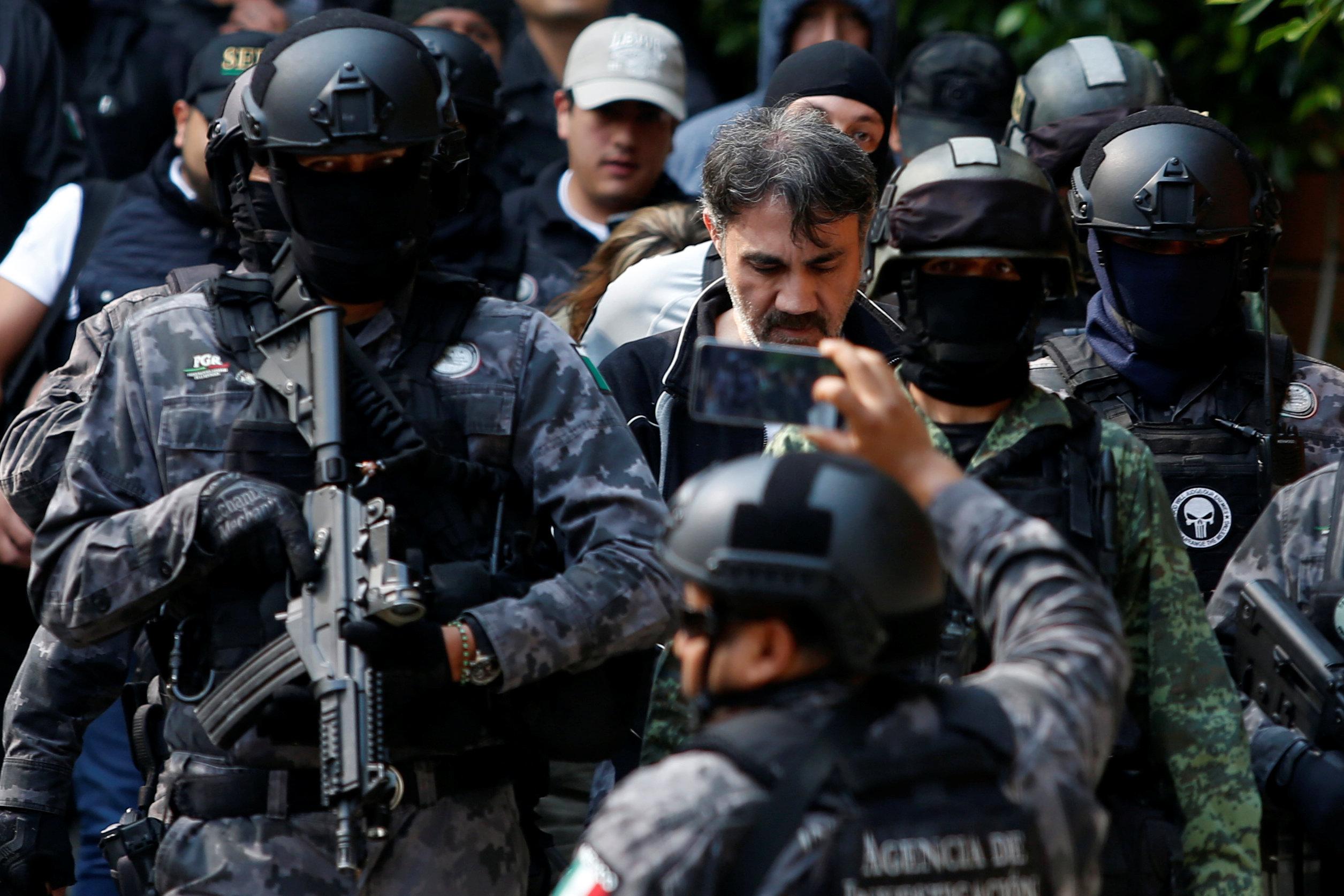 Accused drug kingpin Damaso Lopez (C), nicknamed