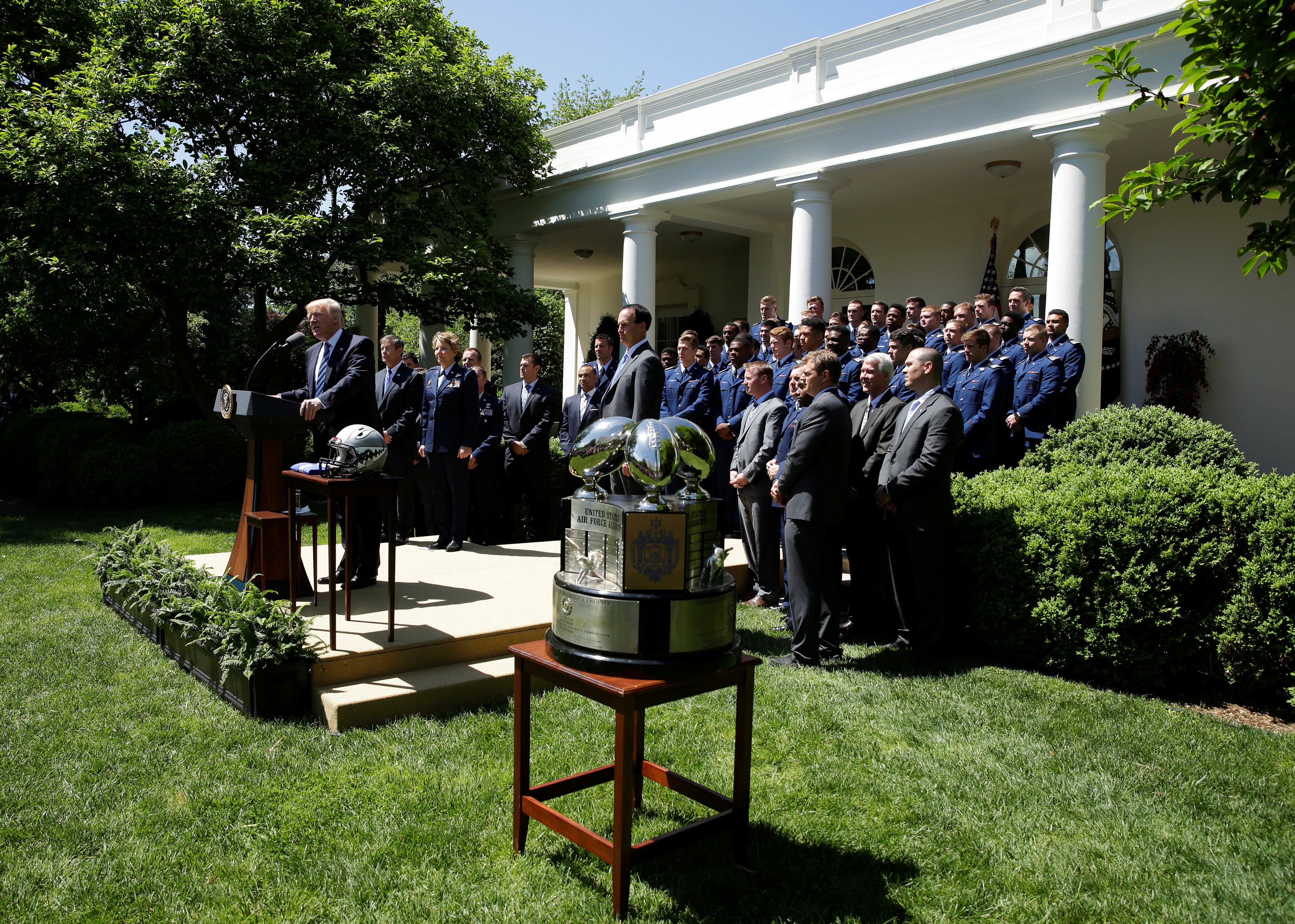 President Donald Trump presents the U.S. Air Force Academy football team with the Commander-in-Chief trophy in the Rose Garden of the White House in Washington on May 2, 2017. (REUTERS/Joshua Roberts)