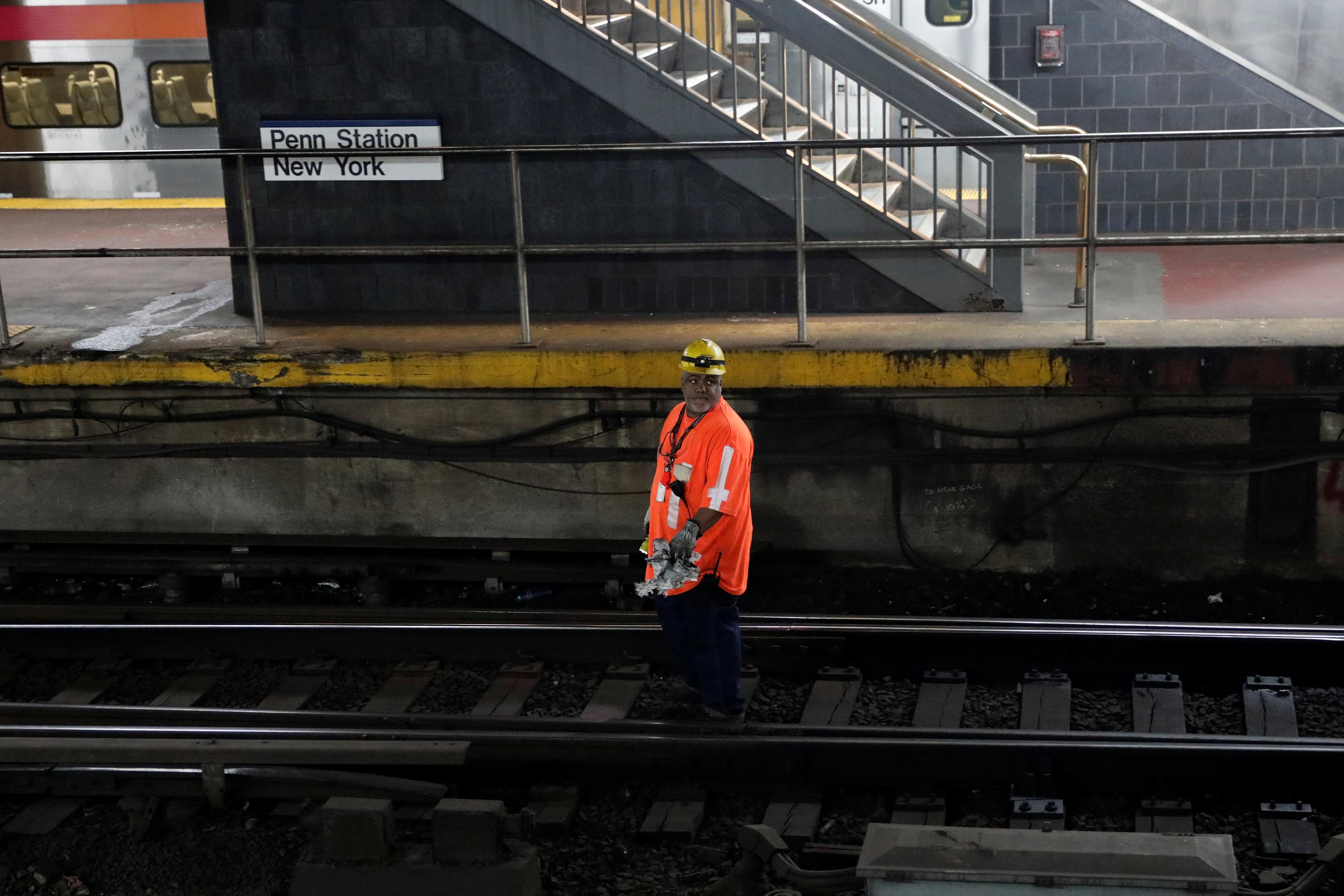 A worker walks on tracks inside New York City's Pennsylvania Station on April 27, 2017. (REUTERS/Mike Segar)