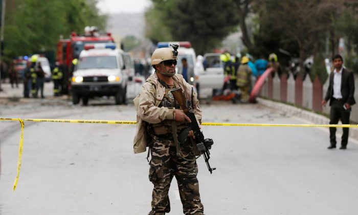 A member of the Afghan security force keeps watch at the site of a suicide attack in Kabul, Afghanistan May 3, 2017. (REUTERS/Omar Sobhani)