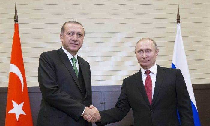 Russian President Vladimir Putin (R) shakes hands with his Turkish counterpart Tayyip Erdogan during a meeting in Sochi, Russia on May 3, 2017.  Both could be the losing parties in the new energy world order.(REUTERS/Alexander Zemlianichenko/Pool)