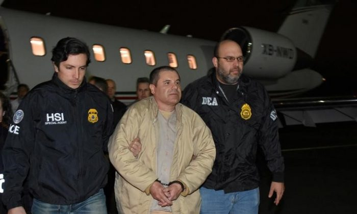 "Mexico's top drug lord Joaquin ""El Chapo"" Guzman is escorted after his extradition from Mexico as he arrives at Long Island MacArthur airport in New York on Jan. 19, 2017. (U.S. officials/Handout via Reuters)"