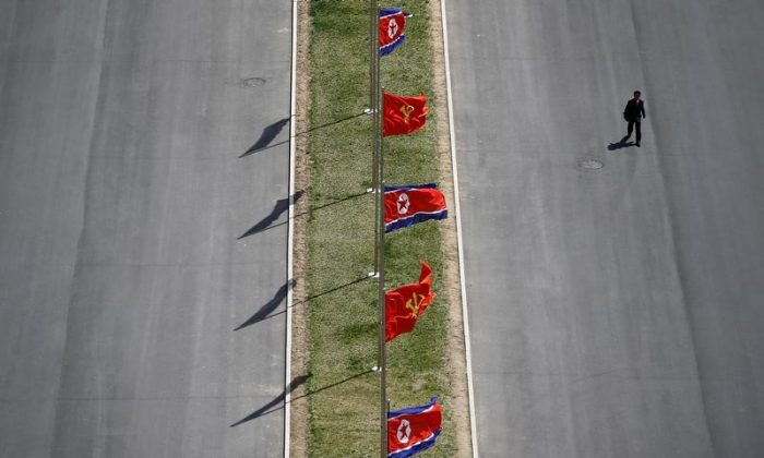 A man walks the the street decorated with flags as North Korea prepares to mark Saturday's 105th anniversary of the birth of Kim Il-sung, North Korea's founding father and grandfather of the current ruler, in central Pyongyang, North Korea on April 12, 2017. (REUTERS/Damir Sagolj)