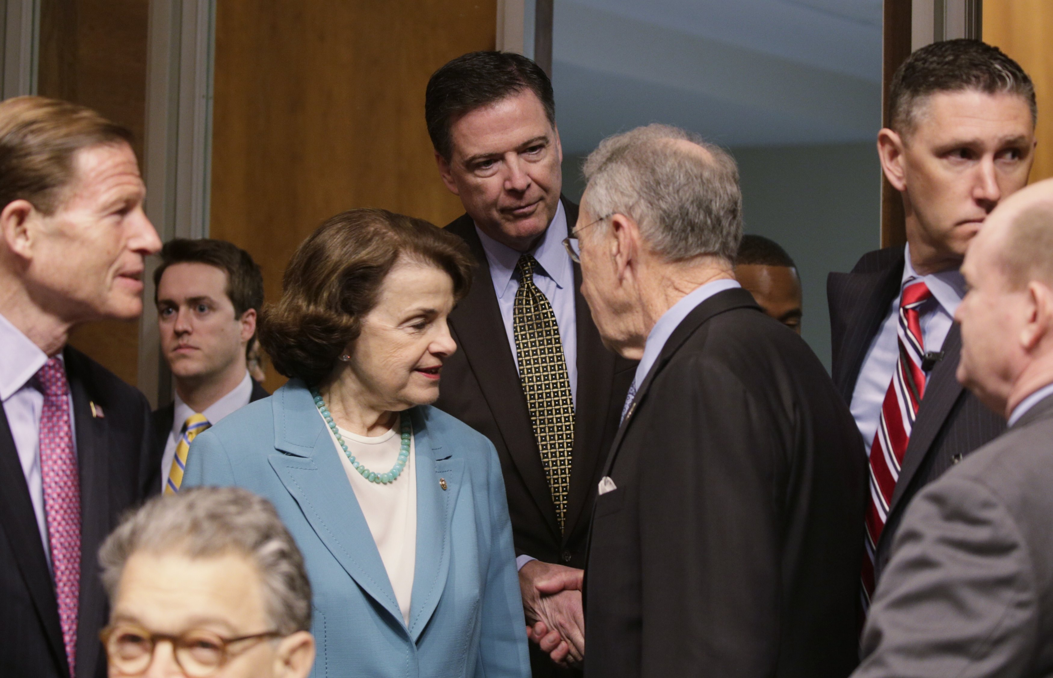 "FBI Director James Comey (C) is greeted by ranking member Sen. Dianne Feinstein (D-CA) (3rdL) and Committee Chairman Chuck Grassley (R-IA) (3rdR) as he arrives to testify before a Senate Judiciary Committee hearing on ""Oversight of the Federal Bureau of Investigation"" on Capitol Hill in Washington on May 3, 2017. (REUTERS/Kevin Lamarque)"