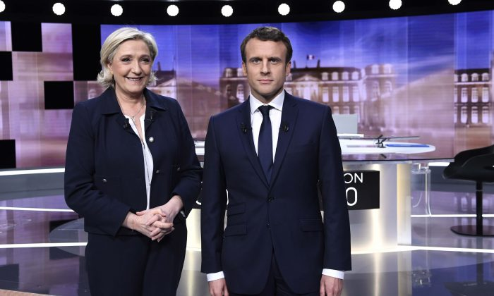 Candidates for the 2017 presidential election, Emmanuel Macron (R) and Marine Le Pen prior to the start of a live prime-time debate in the studios of French television station France 2, and French private station TF1 in La Plaine-Saint-Denis, near Paris, France on May 3, 2017. (REUTERS/Eric Feferberg/Pool)