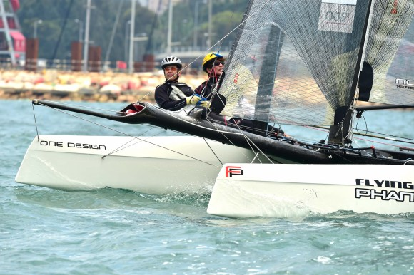 """Mark Thornburrow (L) helming Flying Phantom """"Flyer"""", winner of the RHKYC Tomes Cup in Victoria Harbour on Saturday April 29, 2017. This photo shows """"Flyer"""" prior to the start of the Nations Cup on Sunday April 30, 2017. (Bill Cox/Epoch Times)"""