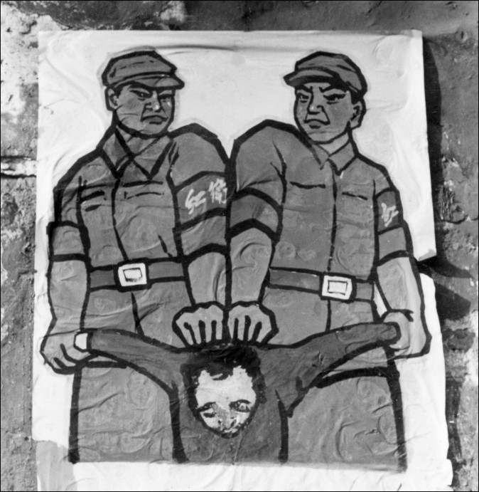 "A Chinese poster in late 1966 showing how to deal with so-called ""enemy of the people"" during the Great Proletarian Cultural Revolution. (Jean Vincent/AFP/Getty Images)"