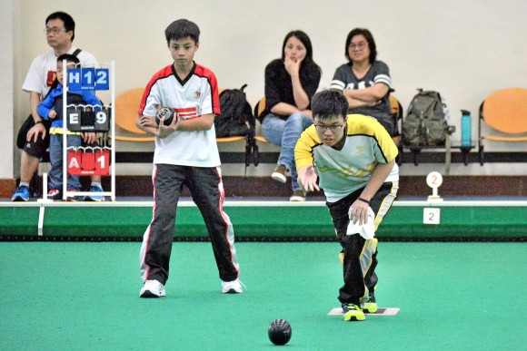 Rayson Law (delivering) from Yan Oi Tong Tin Ka Ping Secondary School defeated his schoolmate Gary Kwan in the final of the Hong Kong Inter-schools Lawn Bowls Competition on Monday, May 1, 2017, to lift the title. (Stephanie Worth)