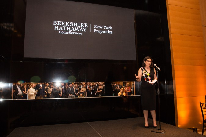 Ellie Johnson, president of the Berkshire Hathaway HomeServices New York Properties, speaks to guests during the celebration of their grand opening location in New York. (Benjamin Chasteen/The Epoch Times)
