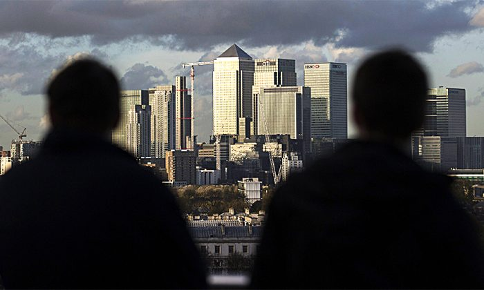 Late afternoon sunshine falls on the financial district in East London in 2014. Some areas of East London have seen a rash of gang related acid attacks carried out by men against other men. (ANDREW COWIE/AFP/GETTY IMAGES)