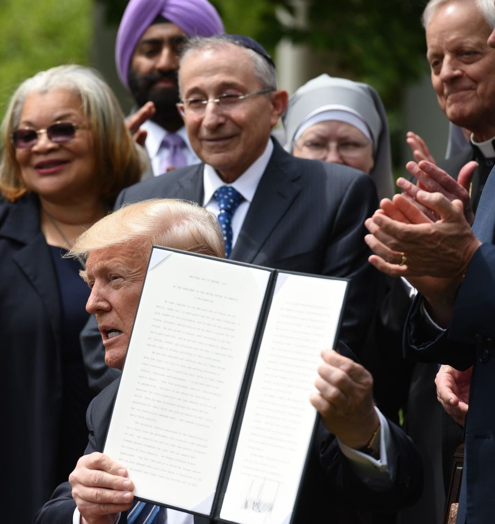 President Donald Trump holds up a proclamation after signing it in the Rose Garden of the White House  in Washington on May 4, 2017. (MANDEL NGAN/AFP/Getty Images)