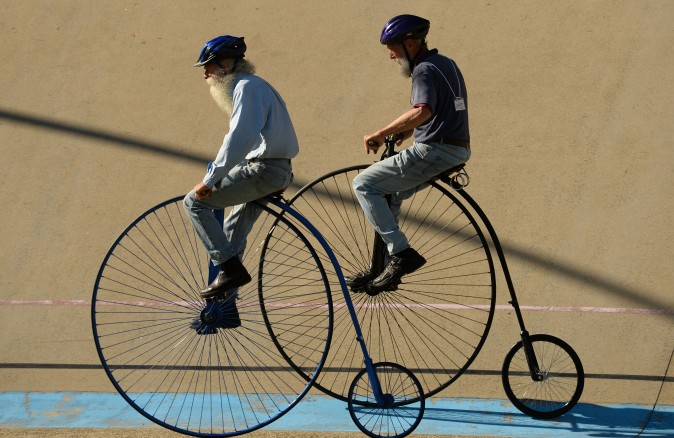 Men ride penny farthing bicycles during the 2017 Sydney Classic Bicycle Show at Canterbury Velodrome in Sydney, Australia, on May 6. The Sydney Classic Bicycle Show is in its fifth year and is run by the Dulwich Hill Bicycle Club, which was started in 1908 and showcases bicycles from the 1800s to the present day. (PETER PARKS/AFP/Getty Images)
