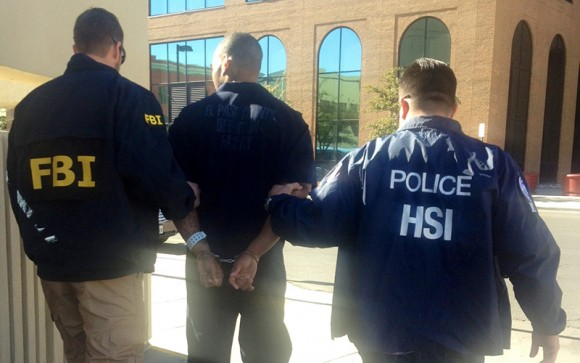 Timothy McCullouch Jr., 28, a juvenile probation officer, is arrested by HSI and FBI special agents on federal sex trafficking charges, in El Paso, Texas, on Jan. 17, 2014. (ICE)
