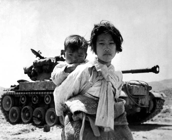 A Korean girl and her brother photographed during their flight from advancing communist forces during the Korean War. (Maj. R.V. Spencer/U.S. Navy)