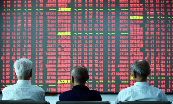Chinese investors sit in front of a screen showing stock market movements at a securities firm in Hangzhou, China, on May 31, 2016. (STR/AFP/Getty Images)