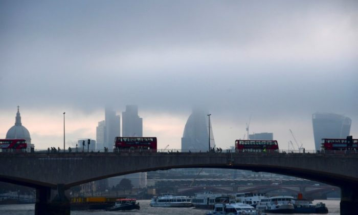 City workers cross the River Thames with the City of London financial district seen behind them, in Britain on Oct. 27, 2016. (REUTERS/Toby Melville)