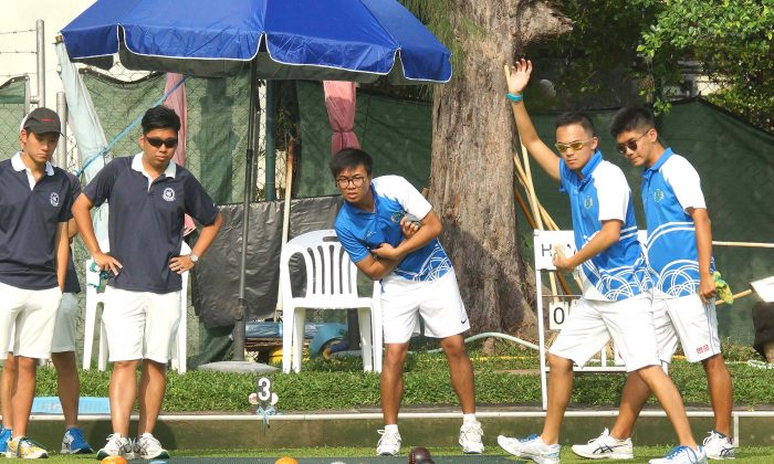 Adrian Yau (second from right) of the Youth Development Team waived to indicate a good bowl from skipper Jason Choi (not in photo) during the semi-final of the National Fours last Sunday, May 7. 2017. But the performance was not good enough to take them through to the final as they were defeated by Craigengower Cricket Club 17-14. (Mike Worth)