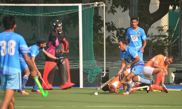 NBC Goalkeeper, Singh Dilyadav and Farooz Khan, player/coach clears what should have been another danger on the NBC-A goal. (Eddie So)