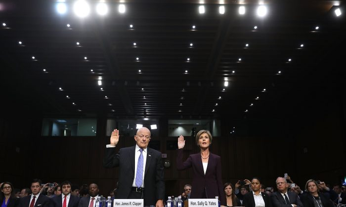 Former Director of National Intelligence James Clapper and former acting U.S. Attorney General Sally Yates are sworn in before testifying to the Senate Judiciary Committee's Subcommittee on Crime and Terrorism on May 8. (Chip Somodevilla/Getty Images)