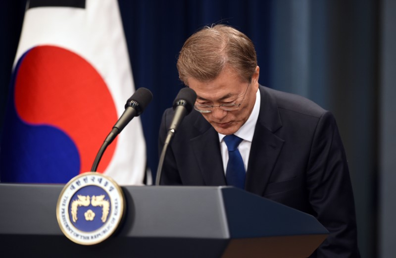 South Korea's new President Moon Jae-In bows during a press conference at the presidential Blue House in Seoul on May 10, 2017. (REUTERS/Jung Yeon-Je/Pool)