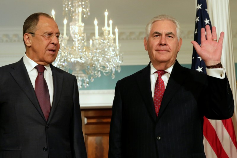 Secretary of State Rex Tillerson (R) waves to the media next to Russian Foreign Minister Sergey Lavrov before their meeting at the State Department in Washington on May 10, 2017. (REUTERS/Yuri Gripas)