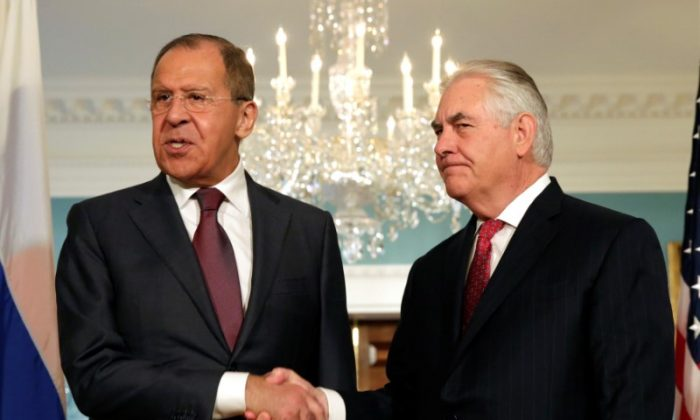 Secretary of State Rex Tillerson (R) shakes hands with Russian Foreign Minister Sergey Lavrov before their meeting at the State Department in Washington on May 10, 2017. (REUTERS/Yuri Gripas)