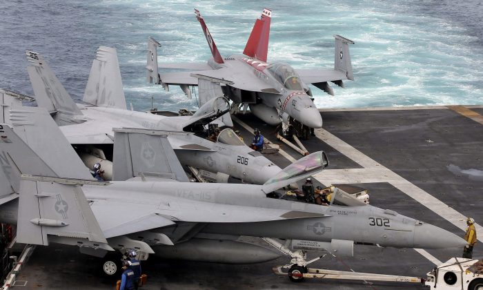 FA-18 Super Hornets sit on the flight deck of the USS George Washington during joint military drills in South Korea's East Sea on July 25, 2010. (AP Photo/Yonhap, Lee Jung-hoon)