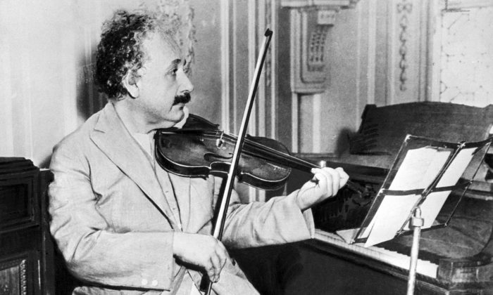 Physicist Albert Einstein playing the violin in 1931. (-/AFP/Getty Images)