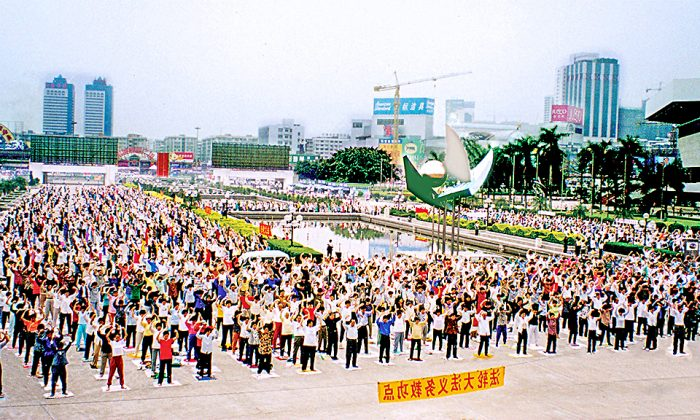 "Thousands of Falun Gong practitioners perform one of the practice's five exercises, the ""Falun Standing Stance,"" in Guangzhou, southern China, in 1998."