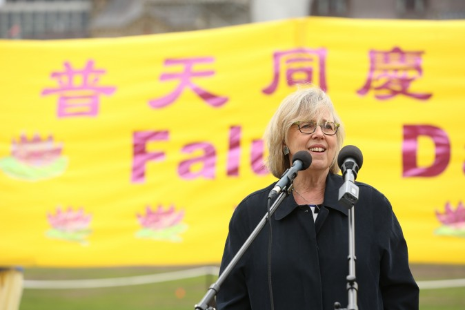 Green Party leader Elizabeth May speaks at a celebration on Parliament Hill marking the 25th anniversary of Falun Gong, May 9, 2017. (Evan Ning/Epoch Times)