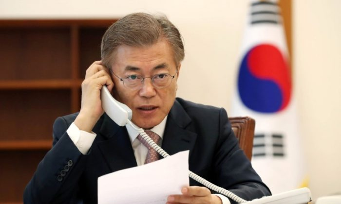 South Korean President Moon Jae-in speaks with Chinese leader Xi Jinping by telephone at the Presidential Blue House in Seoul, South Korea in this handout picture provided by the Presidential Blue House and released by Yonhap on May 11, 2017. (Blue House/Yonhap via REUTERS)