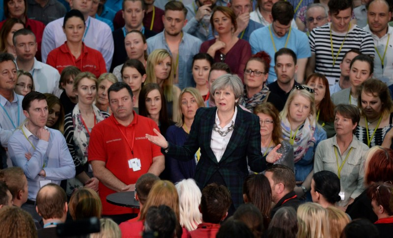 Britain's Prime Minister Theresa May speaks at a general election campaign event at marketing services group Linney, in Mansfield on May 10, 2017.(REUTERS/Oli Scarff/Pool)
