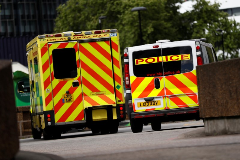 An ambulance waits next to a police car, outside the emergency department, at St Thomas' Hospital in central London, Britain on May 12, 2017. (REUTERS/Stefan Wermuth)