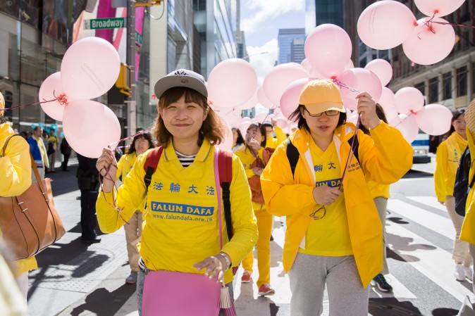 Thousands of Falun Gong practitioners march in a parade along 42nd Street in New York for World Falun Dafa Day on May 12, 2017. (Samira Bouaou/The Epoch Times/The Epoch Times)