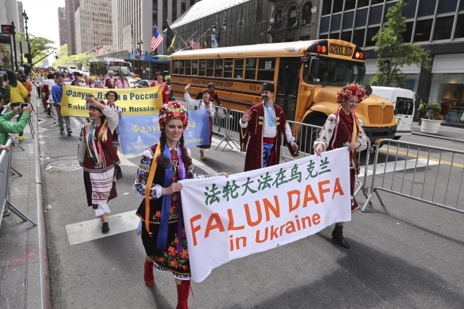 Falun Gong Practitioners from Ukraine march in the World Falun Dafa Day parade in New York on May 12, 2017. (Edward Dye/The Epoch Times)
